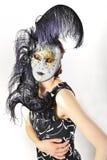 Muchacha en una máscara veneciana aislada Fotos de archivo
