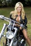Muchacha en una motocicleta Imagen de archivo
