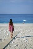 Muchacha en una playa Imágenes de archivo libres de regalías