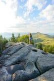 Muchacha en una roca Fotografía de archivo libre de regalías