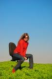 Muchacha en una silla Imagenes de archivo