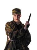 Muchacha en uniforme con un arma y un cuchillo Fotografía de archivo