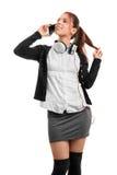 Muchacha en uniforme escolar que habla en el teléfono, aislado en b blanco Fotos de archivo libres de regalías