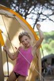Muchacha en vacaciones que acampan Foto de archivo libre de regalías