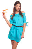 Muchacha en vestido azul con el aislante de los vidrios en el fondo blanco Fotos de archivo libres de regalías
