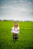 Muchacha en vestido nacional Fotografía de archivo libre de regalías