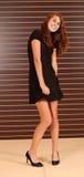 Muchacha en vestido negro Imagen de archivo libre de regalías