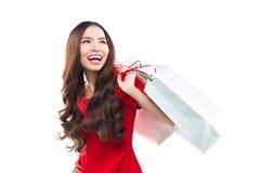 Muchacha en vestido rojo con los panieres Fotos de archivo libres de regalías