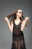 Muchacha en vidrios con el pelo largo rubio Foto de archivo libre de regalías