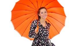 Muchacha encantadora con el umbrel anaranjado Fotografía de archivo libre de regalías