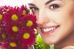 Muchacha encantadora con la flor roja Imágenes de archivo libres de regalías