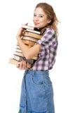 Muchacha encantadora con la pila de libros Fotos de archivo libres de regalías