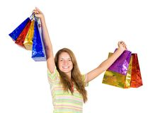 Muchacha encantadora con los bolsos de compras Foto de archivo libre de regalías