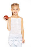 Muchacha encantadora con una manzana Imágenes de archivo libres de regalías