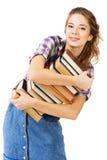 Muchacha encantadora con una pila de libros Imágenes de archivo libres de regalías