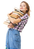 Muchacha encantadora con una pila de libros Foto de archivo