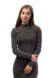 Muchacha encantadora delgada en un vestido gris en el estudio Fotos de archivo libres de regalías