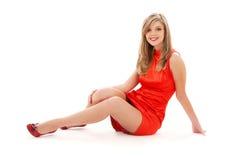 Muchacha encantadora en alineada roja Fotografía de archivo libre de regalías