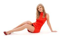 Muchacha encantadora en alineada roja Fotos de archivo