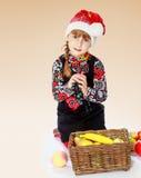 Muchacha encantadora en un casquillo del Año Nuevo Imagen de archivo