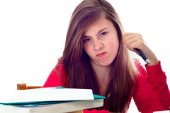 Muchacha enojada con el trabajo de la escuela Imagen de archivo libre de regalías