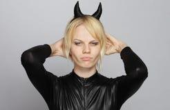 Muchacha enojada con el traje del diablo Imágenes de archivo libres de regalías