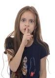 Muchacha enojada con gesto del silencio Foto de archivo
