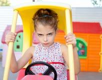 Muchacha enojada de los niños del programa piloto de coche del juguete Fotos de archivo libres de regalías