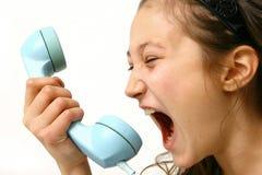 Muchacha enojada en el teléfono Imagen de archivo libre de regalías