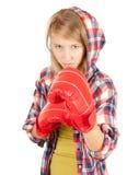 Muchacha enojada en guantes de boxeo Fotografía de archivo libre de regalías