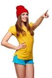 Muchacha enrrollada adolescente que se coloca con un marco Foto de archivo