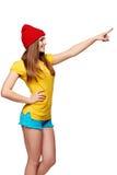 Muchacha enrrollada adolescente que se coloca con un marco Fotografía de archivo libre de regalías