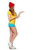 Muchacha enrrollada adolescente que se coloca con un marco Imagen de archivo