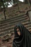 Muchacha extraña en negro Imagen de archivo libre de regalías