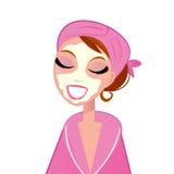Muchacha facial del balneario que desgasta el traje de baño rosado