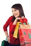 Muchacha feliz con compras de la Navidad Foto de archivo