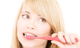 Muchacha feliz con el cepillo de dientes Foto de archivo libre de regalías