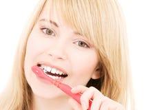Muchacha feliz con el cepillo de dientes Imagen de archivo