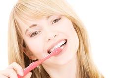 Muchacha feliz con el cepillo de dientes Fotografía de archivo