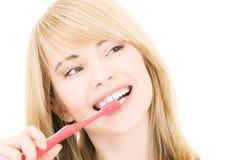 Muchacha feliz con el cepillo de dientes Imagenes de archivo