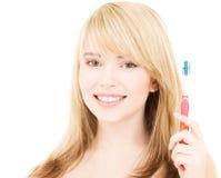Muchacha feliz con el cepillo de dientes Fotos de archivo libres de regalías