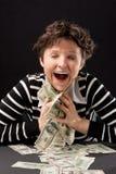 Muchacha feliz con el dinero Foto de archivo libre de regalías