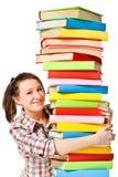Muchacha feliz con el libro del color de la pila Fotos de archivo