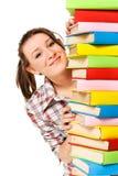 Muchacha feliz con el libro del color de la pila Imagen de archivo