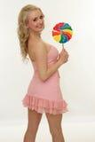 Muchacha feliz con el lollipop Fotos de archivo libres de regalías