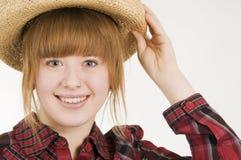 Muchacha feliz con el sombrero de paja Imagen de archivo libre de regalías