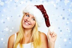 Muchacha feliz con el sombrero de santa Imagen de archivo