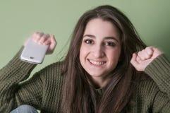 Muchacha feliz con el teléfono Imagen de archivo libre de regalías