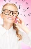 Muchacha feliz con el teléfono celular Imágenes de archivo libres de regalías