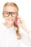 Muchacha feliz con el teléfono celular Imagen de archivo libre de regalías